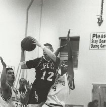 Image of Liberty HIgh School Basketball game featuring Eric Bergman #12. - Issaquah Press Collection