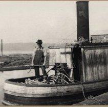 Image of Art Barker on a Steam Tugboat on Lake Sammamish, 1927-1928 -