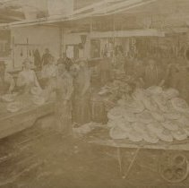 Image of Workers in T.M. Sinclair plant, Early 1900's.