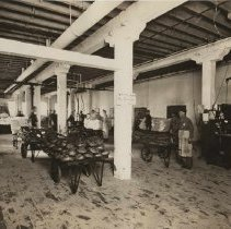 Image of Workers in T.M. Sinclair plant, March 1912.