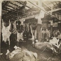 Image of Meat processing in T.M. Sinclair plant, May 1912.