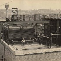 Image of Man on building at T.M Sinclair & Co., 1917.