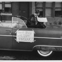 Image of Man and dog in car during Local P3 Union strike in Cedar Rapids, IA, 1959.