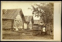 Image of Photograph, Cabinet - Two Unidentified Women, One Unidentified Male Child, several buildings, trees