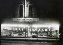 Image of Culbertson Hardware at Night - Eckhart Public Library Photo Collection