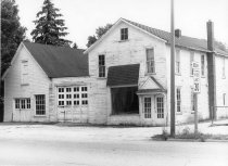 Image of Frame Building on East 7th Street - Eckhart Public Library Photo Collection