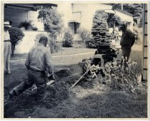 Image of Two men using a trencher to place gas lines - John Martin Smith Miscellaneous Collection