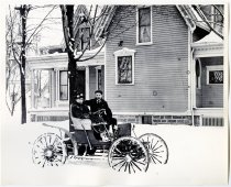 Image of Two People Posing in a Zimmerman Automobile in Front of a House on Indiana Avenue - John Martin Smith Miscellaneous Collection