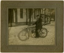 Image of Man on a bicycle in the snow - John Martin Smith Miscellaneous Collection