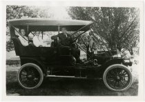 Image of Man, woman and child sitting in an automobile - John Martin Smith Miscellaneous Collection