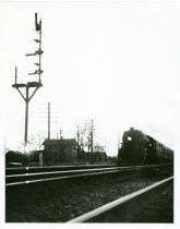 Image of Train moving through Waterloo, Indiana near the WX tower - John Martin Smith Miscellaneous Collection
