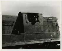 Image of Engineer looking out of locomotive engine No. 5593  - John Martin Smith Miscellaneous Collection