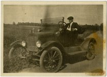 Image of Man sitting in an old automobile with Indiana license plate - John Martin Smith Miscellaneous Collection
