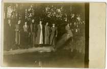 Image of Group of people posing on a tree in a body of water - John Martin Smith Miscellaneous Collection