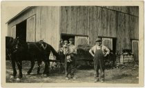 Image of Three farmers and a small child posed in front of a horse and buggy and barn - John Martin Smith Miscellaneous Collection