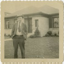 Image of Man standing in front of a house - John Martin Smith Miscellaneous Collection