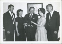 Image of Don Lash and family with trophy - Extraordinary Hoosiers: Don Lash Collection