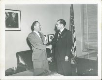 Image of Don Lash shaking hands with another man. (Photo 5 of 6) - Extraordinary Hoosiers: Don Lash Collection