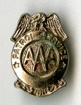 Image of 2014.12.06 - This is a silver AAA Patrol Service button. The pin depicts an eagle sitting atop a round shield with the AAA stamp in the center.
