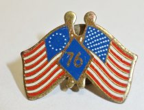 "Image of 2014.12.06 - This is Don Lash's USA Bicentennial pin, depicting the 1776 American flag alongside the current American flag with ""76"" inside a diamond shape in between them."