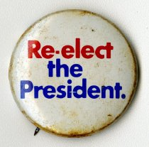 "Image of 2014.12.06 - This is a white button printed with the words ""Re-elect the President"" written in red and blue text. The back edges of the button indicate that the button is in support of re-electing then-President Richard Nixon."