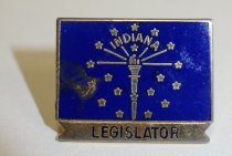 """Image of 2014.12.06 - This is Don Lash's blue pin of the Indiana state flag with the word """"Legislator"""" printed at the bottom."""