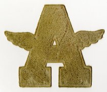 Image of 2014.12.06 - This is Don Lash's white Auburn High School varsity letter with wings on the sides. 
