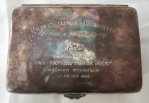 "Image of 2014.12.06 - This is a container with ""Princeton Athletic Association Second Annual Invitation Track Meet Palmer Stadium June 15th 1935"" printed on the top."