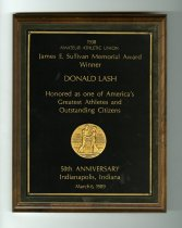 """Image of 2014.12.06 - This is Don Lash's plaque commemorating his award as recipient of the 1938 Amateur Athletic Union's John E. Sullivan Memorial Award which honored him as """"one of America's Greatest Athletes and Outstanding Citizens""""."""