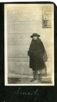 Image of Sebring Photo Album - Young Woman Outside City National Bank - John Martin Smith Miscellaneous Collection