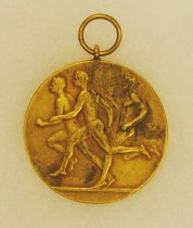 Image of 2014.12.06 - This is a second gold medal from Don Lash's collection that shows 3 runners on the front and an emblem with ICAA on the back.
