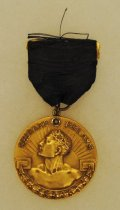 Image of 2014.12.06 - This is Don Lash's 1939 Medal for First Place in the 3 Mile Run at the Chicago Relays.
