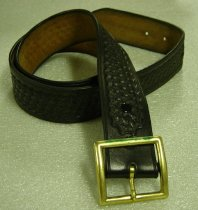 Image of 2009.005 - San Mateo County Sheriff's Office belt.  Black leather uniform belt (size 40) has basketweave pattern and solid brass, square buckle.  Two metal snaps secure buckle to belt; outer snap surfaces are painted black to match belt color.