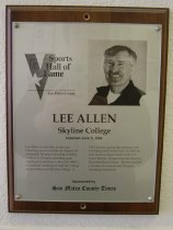"""Image of 2009.030.002 - Plaque commemorating Lee Allen being inducted into the San Mateo County Sports Hall of Fame on June 3, 1998.  Plaque includes image of  Allen and a brief biography:  """"Lee Allen is a wrestler to the core. Growing up as a wrestler in Oregon, he eventually became a two-time member of the U.S. Olympic wrestling team. Moving to California in the early 1960's, he coached wrestling at both the College of San Mateo and Skyline College. In 1979, he was named the national AAU wrestling coach of the year. In 1980, he was chosen as head coach of the U.S. Greco-Roman Olympic team but America boycotted those Games. He has coached a number of National and Olympic wrestling champions."""""""