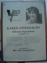 """Image of 2009.030.008 - Plaque commemorating Karen Athanacio being inducted into the San Mateo County Sports Hall of Fame on May 23, 1996.  Plaque includes image of  Athanacio and a brief biography:  """"Karen Athanacio was a San Mateo County prep softball pioneer.  In the early 1980s, she became the first in a long line of local fast-pitch specialists who dominated hitters with year-in-year-out regularity.  Athanacio, who attended Hillsdale High in San Mateo, produced an overall, four-year 89-9 record as a prep.  Her Hillsdale teams won two Central Coast Section softball championships.  She was so predictably fast - and her pitches moved around with such startling ease - that no-hitters were common for her.  Shutouts were the norm.  She later attended Texas A&M on a softball scholarship."""""""