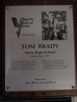 """Image of 2009.030.023 - Plaque commemorating Tom Brady of Serra High School being inducted into the San Mateo County Sports Hall of Fame on June 10, 2003.  Plaque includes image of Brady and a brief biography:  """"Persistence and belief in himself.  That sums up the brilliant football career of Tom Brady.  After attending Serra High School, he went to Michigan where he blossomed in his final two years.  As a starting quarterback, he passed for 5,351 yards and 35 touchdowns as his team went 20-5 and won the Orange Bowl crown.  In 2001, he took over as the starting New England QB well into the NFL season and guided the Patriots to a shocking Super Bowl victory.  He was the game's MVP."""""""