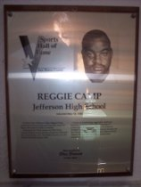 "Image of 2009.030.034 - Plaque commemorating Reggie Camp of Jefferson High School being inducted into the San Mateo County Sports Hall of Fame on May 18, 1993.  Plaque includes image of Camp and a brief biography:  ""At Daly City's Jefferson High, Reggie Camp could never have envisioned what lay ahead for him in the violent world of football.  During his first three seasons at the North County school, losing was the program's hallmark.  But, in his senior year, the Indians nearly won the North Peninsula League title.