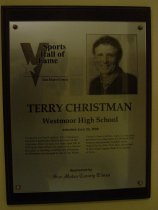 "Image of 2009.030.040 - Plaque commemorating Terry Chistman of Westmoor High School being inducted into the San Mateo County Sports Hall of Fame on June 22, 2006.  Plaque includes image of Christman and a brief biography:  ""For nearly a full half-century, Terry Christman has been a significant athletic presence on the Peninsula.  From his days as a multi-sport star at Westmoor High School, he went on to a successful career in teaching, coaching and officiating.  At Westmoor, he emerged as one of San Mateo County's finest pitchers.  Later, he was a key performer on consecutive Far Western Conference championship baseball teams.  Drafted by the New York Mets, he pitched in their minor league chain for a number of years."""