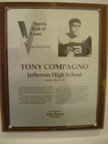 "Image of 2009.030.043 - Plaque commemorating Tony Compagno inducted into the San Mateo County Sports Hall of Fame on May 28, 1991.  Plaque includes image of  Compagno and a brief biography:  ""Tony Compagno was the first athlete inducted into the Jefferson High School Sports Hall of Fame when it opened.  He was a slashing runner who starred in high school, college and the professional ranks.  After graduating from Jefferson, he attended St Mary's College where he was a standout for the Gaels in classic battles with Fordham University.  His college feats gained him a berth on the East-West Shrine football team in 1942.  After serving in the U.S. Army during World War II, Compagno became a starting fullback for the Pittsburgh Steelers.  He played offense and defense for the Steelers from 1945 to 1949.  In one memorable game in 1947, he was one of a trio of Steelers to score a touchdown in a period of 108 seconds against the New York Giants.  He retired from professional football in 1950 and assisted with high school sports as an official until his death at the age of 50."""