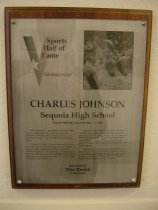 "Image of 2009.030.092 - Plaque commemorating Charles Johnson being inducted into the San Mateo County Sports Hall of Fame on May 17, 1989.  Plaque includes image of Johnson and a brief biography:  ""Charles Johnson, a graduate of Sequoia High School in Redwood City, took his Peninsula basketball training to the ultimate.  He played and often started on two NBA championship teams.  /  Johnson, at 5 foot 11, twice was named Most Valuable Player of the South Peninsula Athletic League while at Sequoia.  He then went on to attend a play for the University of California at Berkeley where he won the Naismith Award, given annually to the best player in the U.S. under 6 feet in height, his senior year.  /  Johnson went to the Golden State Warriors of the NBA as a sixth-round draft choice, and his teams never had a losing season.  He was part of a 1974-75 Golden Gate championship team which swept the Washington Bullets in four straight games.  It was the first NBA crown in the Bay Area club's history.  /  The following year, his Warriors produced their best -ever record, winning 59 games.  Traded to the Washington Bullets, he next was part of yet another professional titlist in 1977-78.  It was the Bullets' first championship in 30 years."""