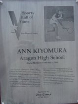 """Image of 2009.030.102 - Plaque commemorating Ann Kiyomura being inducted into the San Mateo County Sports Hall of Fame on May 17, 1989.  Plaque includes image of Kiyomura and a brief biography:  """"Ann Kiyomura, a graduate of Aragon High School in San Mateo, started out her tennis career by dominating age-group singles competition.  But it would be in doubles that she would make her most lasting mark.  /  Kiyomura won 14 U.S. national singles and doubles titles and captured the 1973 junior Wimbledon singles crown, defeating Martina Navratilova of Czechoslovakia.  In a 13-year professional career, she won the National Indoor doubles title, the Japan Open, a number of Avon and Virginia Slims tournaments and represented the U.S. in Wightman Cup play.  In 1975, she teamed with Kazuko Sawamatsu of Japan to win the Wimbledon doubles crown.  /  She also starred for the Oakland-based Golden Gaters and two other franchises in the World Team Tennis league.  She twice won the Bridgestone Doubles championship with Sue Barker and Pam Shriver before retiring in 1985.  Kiyomura turned pro when she was 17 years old."""""""