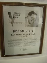 "Image of 2009.030.130 - Plaque commemorating Bob Murphy of San Mateo High School being inducted into the San Mateo County Sports Hall of Fame on May 21, 1991.  Plaque includes image of Murphy and a brief biography:  ""Bob Murphy was woven an illustrious thread through the rich athletic fabric of the Peninsula, starting with his prep days at both Serra and San Mateo high schools.  /  At San Mateo, Murphy helped the Bearcats in the Peninsula Athletic League baseball title in 1949 as a senior third baseman.  In his senior year at Stanford, he switched to pitcher and won 11 games, helping his team make its first-ever appearance in the College World Series in 1953.  /  After college, Murphy signed a contract with the Oakland Oaks of the Pacific Coast League and spent three years in the minors before hanging it up.  /  Murphy's greatest celebrity has come as a witty emcee for sports banquets, where he is in great demand throughout Northern California.  /  His many sports-related endeavors include working as an executive for golf course designer Robert Trent Jones Jr., announcing Stanford basketball and football games and managing an Ohio tournament for golf legend Jack Nicklaus."""