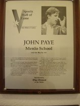 "Image of 2009.030.140 - Plaque commemorating John Paye being inducted into the San Mateo County Sports Hall of Fame on May 28, 1991.  Plaque includes image of Paye and a brief biography:  ""John Paye led Menlo School to two North Coast Section football titles and a state Division II basketball title.  /  If that weren't enough, Paye returned to Menlo after a successful football and basketball career at Stanford and coached the Knights to three consecutive Division V girls' baskeball titles.  /  Paye's football stats at Menlo were phenomenal: completing 550 of 936 passes for 7,515 yards and 80 touchdowns.  In his senior year, Paye threw for 3,363 yards and 41 touchdowns.  Paye was the third California prep quarterback ever to reach the 40 TD mark in a season.  /   He once threw for eight touchdowns in a game - a state record - and he averaged 305.7 yards a game, another state mark.  /  In the NCS title game against Upper Lake in 1982, Paye completed 29 of 48 passes for 382 yards.  /  In basketball, Menlo was going for the state Division II title against  Santa Clara of Oxnard, March 20, 1983, at the LA Sports Arena.  The Knights were protecting a 2-point lead when Paye was fouled with 15 seconds left.  He sank both shots to give Menlo a 53-51 triumph.  Paye scored 27 points against Santa Clara, making 10-of-15 shots from the field, 3-of-8 from the foul line."""