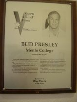 """Image of 2009.030.146 - Plaque commemorating Bud Presley  being inducted into the San Mateo County Sports Hall of Fame on May 28, 1991.  Plaque includes image of  Presley and a brief biography:  """"Bud Presley make his mark on basketball on the Peninsula as a coach at Menlo College during the '70s.  /  His gritty Menlo teams won 266 games and five Coast Conference championships during his 12-year tenure there.  /  On three occasions, his sturdy Oaks played for the California state community college Division II title, winning that crown in 1974.  /  Presley demanded a brand of intense, man-to-man defense that proved to be Menlo's hallmark through much of the '70s.  His Menlo teams led the nation's two-year schools in defense.  /  In his coaching prime, his behavior on the court was legendary.  Vocal and given to uninhibited outbursts, Presley never left any doubts about where he stood.  /  Through the years, Presley worked for several professional teams, including the Warriors, Rockets and Trail Blazers, as a defensive consultant."""""""