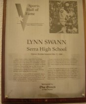 """Image of 2009.030.172 - Plaque commemorating Lynn Swann being inducted into the San Mateo County Sports Hall of Fame on May 17, 1989.  Plaque includes image of Swann and a brief biography:  """"Lynn Swann, a Serra High School graduate, probably played in more important football games than anyone in San Mateo County athletic history.  At Serra, the 6-foot pass receiver was the Northern California Player of the Year in 1969.  He led the Padres to two West Catholic Athletic League championships during his three varsity seasons, during which Serra was 27-3 overall.  /  Swann also was an all-WCAL baskerball player and a prep state champion in the long jump.  He was an all-San Mateo County football player in all three varsity seasons.  During his Serra career, he scored 38 touchdowns for 271 points.  /  Swann went on to the University of Southern California where he became an all-American and played in two Rose Bowls.  He was a first round NFL draft selection of the Pittsburgh Steelers in 1974.  /  With the Steelers, Swann was an all-NFL wise receiver.  He played in thre Pro Bowls and four Super Bowls.  He was the Most Valuable of Super Bowl X in which he set a record with 161 yeards on four receptions.  During his NFL careeer with the Steelers, Swann caught 336 passes for 5,452 yards."""""""