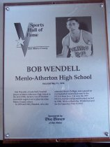 "Image of 2009.030.187 - Plaque commemorating Bob Wendell of Menlo-Atherton High School being inducted into the San Mateo County Sports Hall of Fame on May 31, 1994.  Plaque includes image of Wendell and a brief biography:  ""Bob Wendell, a basketball/baseball player at Menlo-Atherton High School in the mid-1950s, became one of the most successful cagers ever to play for a San Mateo County school.  /  In 1959 and 1960, Wendell, who also attended Menlo College, was a guard on Cal basketball teams that went tot eh NCAA Final Four.  Cal won the 1959 NCAA championship and finished second in 1960.  While at Berkeley, Wendell played for the legendary Pete Newell."""