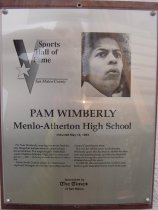 "Image of 2009.030.193 - Plaque commemorating Pam Wimberly of Menlo-Atherton High School being inducted into the San Mateo County Sports Hall of Fame on May 18, 1993.  Plaque includes image of Wimberly and a brief biography:  ""For Pam Wimberly, winning has never been the only thing that matters when it comes to high school athletics.  The longtime girls' basketball coach at Menlo-Atherton High, she has won more games - 568 - than any female mentor in California.  /  At the South County school, her teams have captured 14 league varsity championships and four Central Coast Section titles.  /  But it is her off-the-court work that sets Wimberly apart.  She has been a stickler for decorum and sportsmanship, and she has imparted those often-forgotten qualities to her student athletes through the years.  /  In 1992-93, she was named the Cental Coast Section girls' basketball honor coach of the year."""