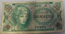 Image of 2010.090.014 - US Army Payment Script valued at 10 cents and created to be used during Vietnam at Military establishments (i.e. PX - Post Exchange). c. 1966.  Green bill with image of a woman on front and eagle on back.  Dimensions:  2.125 x 4.25""