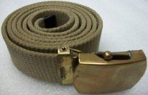 "Image of 2010.090.080 - WWII U.S. Army Belt, c. 1939-1944.  Canvas belt with plain brass buckle.  Brown khaki canvas belt with plain solid brass buckle.  ""U.S. 1 Q[?] M D 1943"" & ""44"" printed in black on back of canvas near buckle."