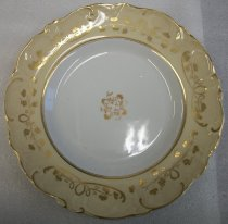 "Image of 2010.092.018D - Holbrook-Palmer Dinner Plate, mid-19th century.  One of a set of eight (2010.092.018A-H) mid-19th century French style dinner plates.  ""Improved Stone China"" stamped into back and ""2560"" written in red on back.  White plate with beige colored border and gold painted floral motif along border and in center.  Scalloped and textured edge."